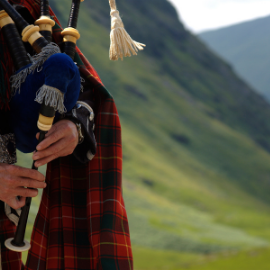 Bagpipe player in traditional dress