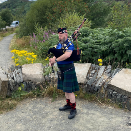 Tour Leader Fergie playing the bagpipes, taken by one of our passengers