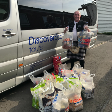 Tour Leader Michael with the bags of foodbank donations