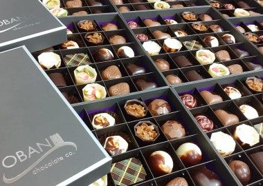 An image showing 8 boxes of chocolate side by side from the Oban Chocolate company